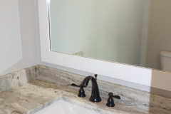 Custom cut granite countertops and backsplash are standard in all bathrooms